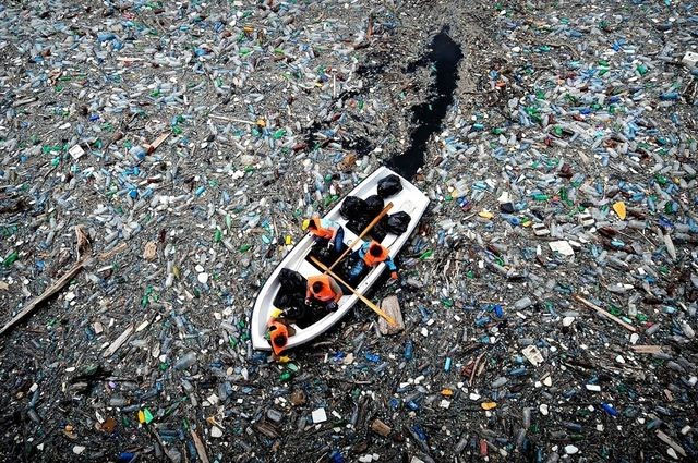 PET plastic pollution around boat