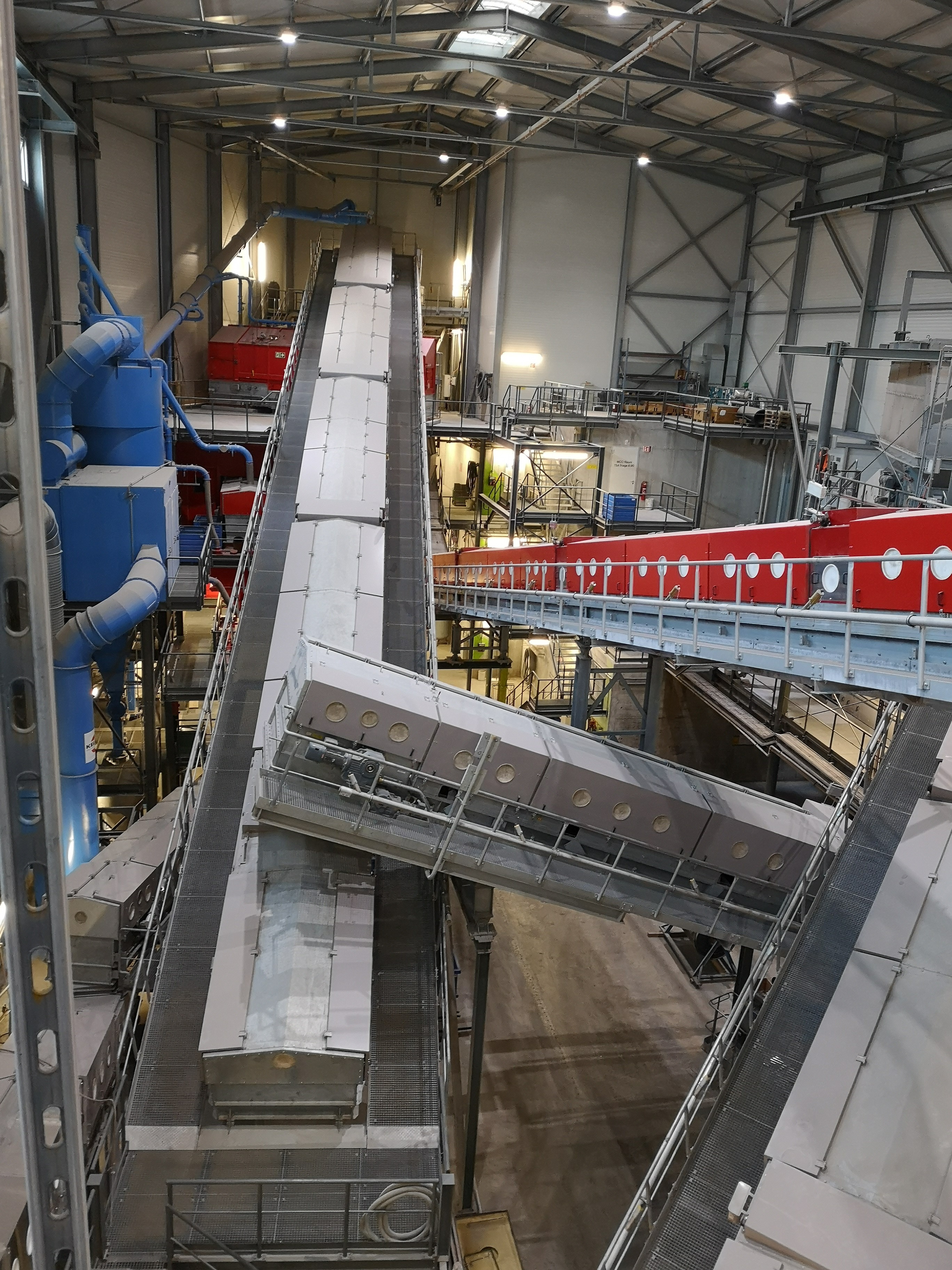 Then it leads on tape to the dry slag plant of zav recycling ag. After the step that i mentioned above, it leads to other different steps and then it goes to the handsorting and breaking and separating machines (Förderband zur Handsortierung)